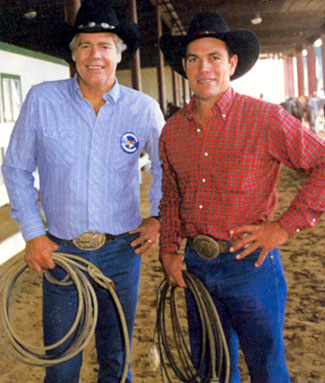 "Rodeo rider Phil Lyne (right) with team roping partner Doug McClure (""The Virginian"", ""Overland Trail"", ""Barbary Coast"") at the 1986 Bum Phillips Invitational Celebrity Roping in Houston, Texas."