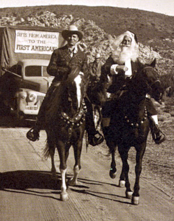 Gene Autry rides a 1949 Christmas trail with Santa Claus.