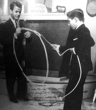 "Johnny Crawford demonstrates the art of rope twirling to Dick Clark on ""American Bandstand""."
