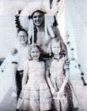 "Robert and sisters Sherron and Beverly Moser with ""Brave Eagle"" Keith Larsen."