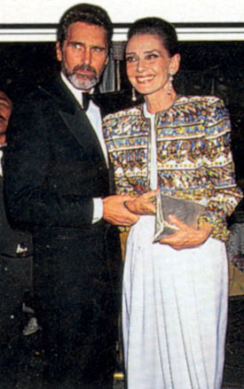 "A true gentleman, Robert Wolders (Ranger Erik Hunter on ""Laredo""), the longtime companion of Audrey Hepburn, seen here escorting the actress turned UNICEF Goodwill Ambassador to a ceremony in her honor hosted by the Film Society of Lincoln Center."