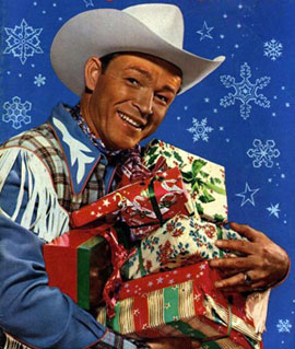 Roy Rogers holding Christmas gifts.