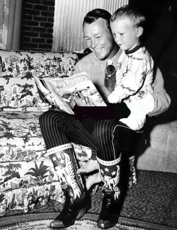 Christmastime as Roy reads one of his comic book adventures to son Dusty. (Thanx to Jerry Whittington.)