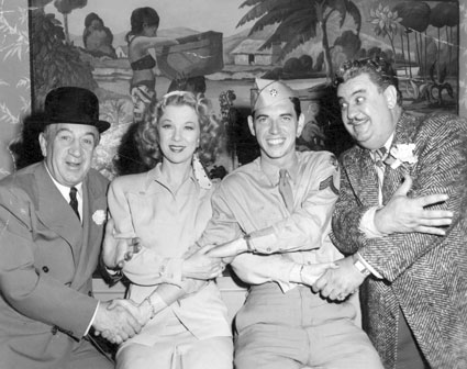 "Comedians Hugh Herbert (left) and Billy Gilbert (right) join hands with Glenda Farrell and her son Tommy Farrell while Tommy was performing in ""Winged Victory"" ('44) on Broadway. Tommy later co-starred in Westerns with Don Barry, Whip Wilson and others."