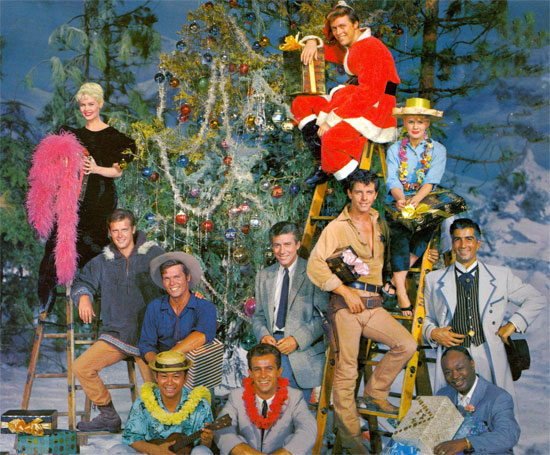 "The photo cover to the 1959 Warner Bros.' ""We Wish You a Merry Christmas"" LP. (L-R: bottom row) Poncie Ponce and Robert Conrad of ""Hawaiian Eye"", Eddie Cole of ""Bourbon Street Beat"" (middle row) Roger Moore of ""The Alaskans"", Ty Hardin of ""Bronco"", Efrem Zimbalist Jr. of ""77 Sunset Strip"", Peter Brown of ""Lawman"", Ray Danton of ""The Alaskans"" (top row) Dorothy Provine of ""The Alaskans"", Edward Byrnes of ""77 Sunset Strip"", Connie Stevens of ""Hawaiian Eye"". Each star sang one of the 14 songs on the LP and all joined in for ""We Wish You a Merry Christmas""."