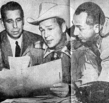 Roy with manager Art Rush (left) and publicity man Al Rackin.