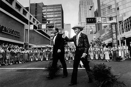 Roy walks with his son Dusty down the red carpet on their way to the Salute To Our Stars gala at the Cincinnati, OH, bi-centennial on July 9, 1988.