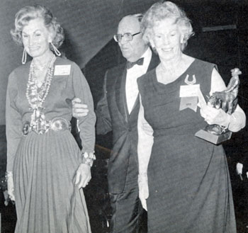 Mrs. Buck Jones (right) and daughter Maxine Firfires (left) are escorted by Gene Autry at the induction of Buck Jones into the Hall of Great Western Performers at the Cowboy Hall of Fame in 1973. Jones died in 1942.