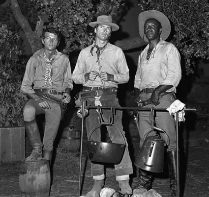 "David Watson, Clint Eastwood and Raymond St. Jacques prepare for a ""Rawhide"" campfire scene on July 20, 1965."