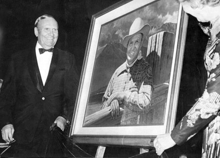 Gene Autry and wife Ina unvail Gene's portrait by Robert Rishell for the Hall of Great Western Performers in 1973 during the Western Heritage Awards in Oklahoma City.
