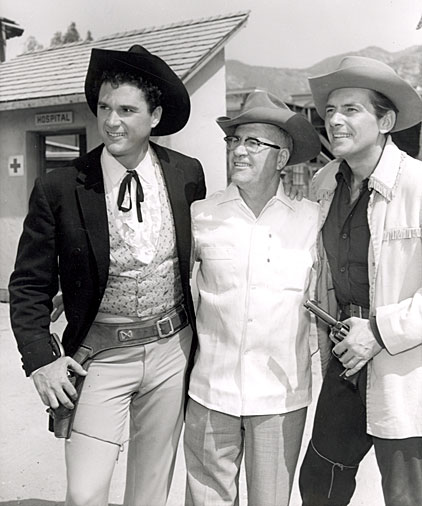 "Robert Colbert and Jack Kelly who starred on Warner Bros.' ""Maverick"" pose with Colbert's father when he visited the Warner Bros. backlot."