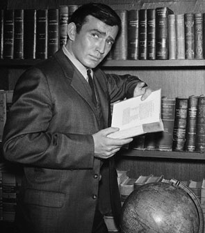 James Drury with a copy of the book that made he and his TV series famous, THE VIRGINIAN by Owen Wister.