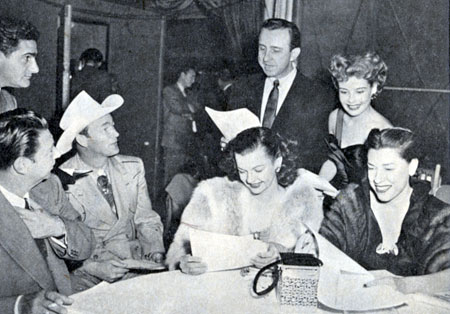 Donating their time to the National Safety Council at L.A.'s Ambassador Hotel in early 1951 are (L-R) NBC's Warren Lewis (standing), Harry Von Zell, Roy Rogers, Dale Evans, Frank De Vol, Gloria De Haven and Judy Canova.