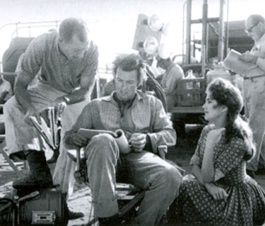 "Director Ted Post goes over a ""Rawhide"" scene with Clint Eastwood. Actress is unknown."