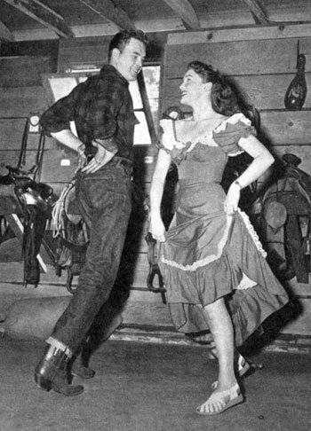 Scott Brady and Joan Leslie brush up on their do-si-dos while square dancing in December '49.