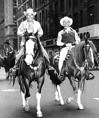 Gene Autry with his rodeo producer (1942-1959) partner Everett Colburn riding in a New York City parade.