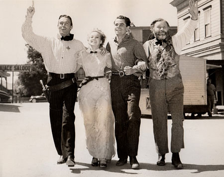 "On the Columbia backlot with Randolph Scott, Claire Trevor, Glenn Ford and Edgar Buchanan while filming ""The Desperadoes"" ('43)."