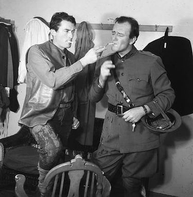 "Gregory Peck visits John Wayne on the set of ""Blood Alley"" ('55 WB)."