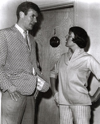 "Keely Smith seems to saying to Will ""Sugarfoot"" Hutchins, ""Where did you get that jacket?"" Will said, ""Same place you got those pants."""