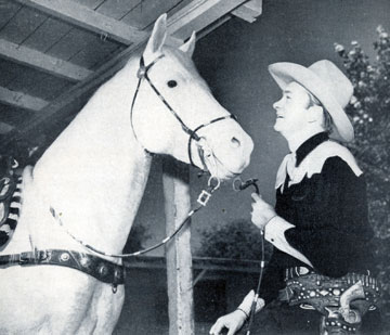 Tex Ritter and his great horse White Flash.
