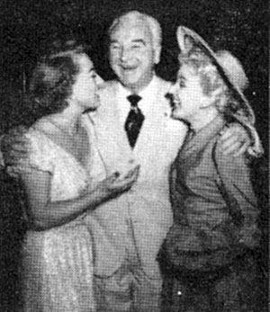 "Joan Crawford chats with Bill (""Hopalong Cassidy"") Boyd and wife Grace Bradley circa 1951."