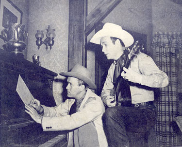 "The songwriting team of Tim Spencer and Roy Rogers in 1943. Together they wrote ""Ride 'Em, Cowboy"", ""Song of the San Joaquin"", ""Faithful Pal O' Mine"", ""Rocky Mountain Lullaby"", ""All Because of You"", ""South of Santa Fe"", ""Curly Joe from Idaho"", ""Grin and Take it On the Chin"" and so many more. All of these and others were published in ROY ROGERS' OWN SONGS FOLIO #1 in 1943."