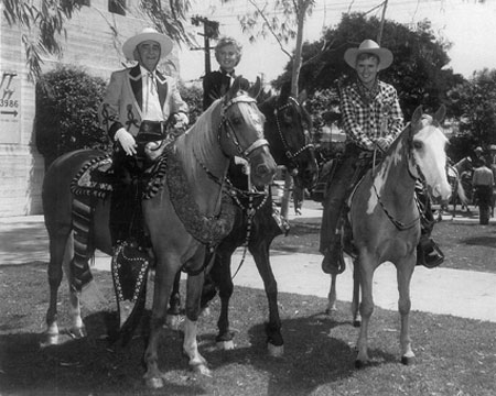 "(Above) Will ""Sugarfoot"" Hutchins was Grand Marshal at the annual Sheriff's Rodeo in L.A. Coliseum in 1958. (L-R) Hutchins, Sheriff Gene Biscailuz, Barbara Stanwyck and a Sheriff's Deputy. (Below) Bizcailuz, Stanwyck, Hutchins."