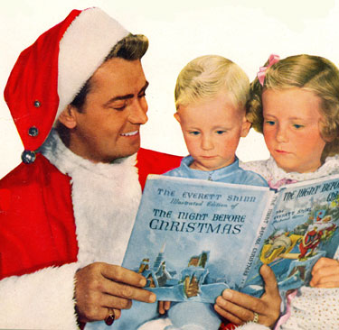 Alan Ladd reads a Christmas story to his children, David and Alana, Christmas 1949.