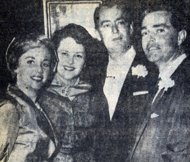 Carol Lee Ladd (left), daughter of Mr. and Mrs. Alan Ladd (center), and Warner Bros. executive John Veitch upon their marriage at the Little Brown Church of the Valley in Hollywood. (2/10/58 UP Telephoto).
