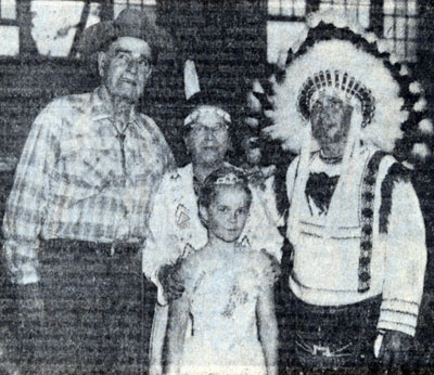 Jack Hoxie appearing on a program at the Derby Stay At Home Camp in North Carolina with (L-R) Galloping Horse (Mrs. Mary Reed), her husband Chief Running Horse (Daniel Reed), and their granddaughter Linda Daniels. Reed's were members of the Cherokee Nation.