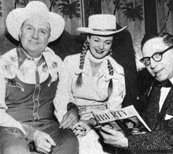Gene Autry and Gail Davis as Annie Oakley interviewed by LIBERTY magazine's Frank Rasky. Gene and Gail performed August 24-September 8, 1956, at the 24,000 seat grandstand at the Canadian National Exhibition in Toronto.