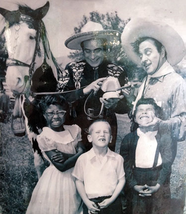 The Cisco Kid (Duncan Renaldo) and Pancho (Leo Carrillo) with a group of fans in the '50s.