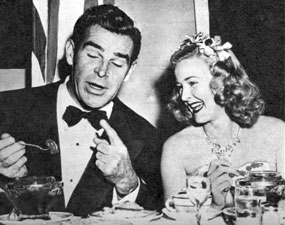 Republic Western star Rod Cameron seems to be telling a funny story to Monogram leading lady Reno Browne at a 1950 dinner party.