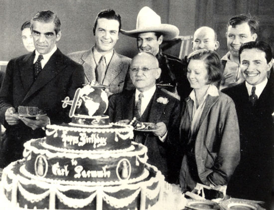 Attending Universal founder Karl Laemmle's 67th birthday on January 17, 1934 are (L-R) Boris Karloff, Hugh Enfield (aka Craig Reynolds), Ken Maynard, Laemmle (in front of Maynard), Margaret Sullivan, Vince Barnette, Andy Devine and Karl Laemmle Jr.