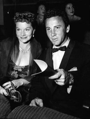 "Cameron Mitchell of the ""High Chaparral"" attends a play in Hollywood with his wife Camille."