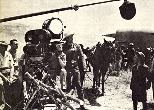 "Clint Walker and crew prepare for a ""Cheyenne"" scene."