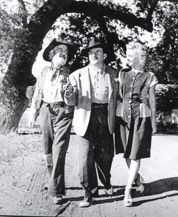 "Director Frank McDonald shows Gabby Hayes and Dale Evans a location for their scene in ""Along the Navajo Trail"" ('45 Republic)."