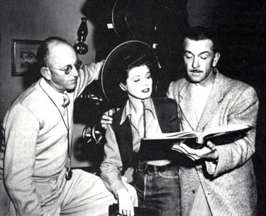 Director John English (right) goes over a script with Gail Davis and Republic  cameraman Bill Bradford.