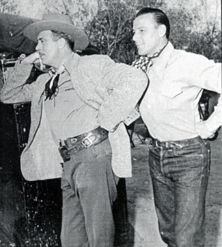 "Badman LeRoy Mason and Bob Nolan of the Sons of the Pioneers wait for their call to do a scene in Monte Hale's ""Home on the Range"" ('46 Republic)."