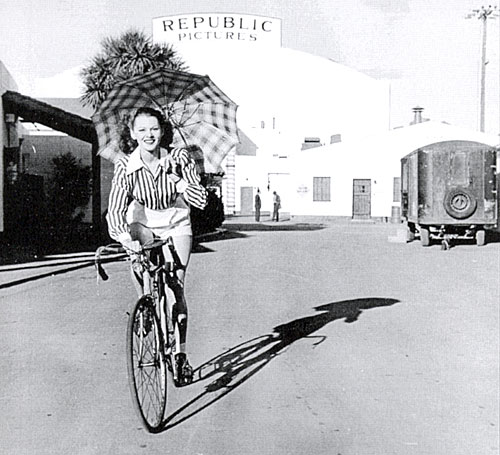 Adrian Booth takes a bike ride around the Republic backlot in 1946.
