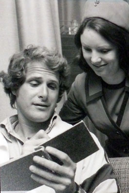 "Ben Murphy of ""Alias Smith and Jones"" signs an autograph book for an Air New Zealand stewardess. (Thanx to Terry Cutts.)"