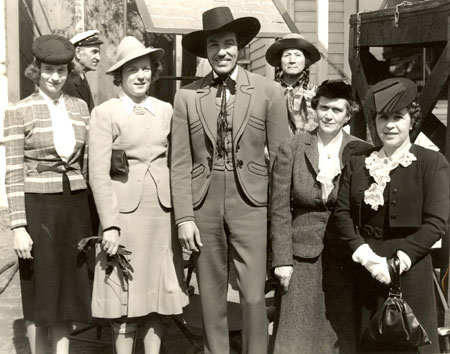 Cesar Romero as the Cisco Kid poses with a group of ladies in 1940.