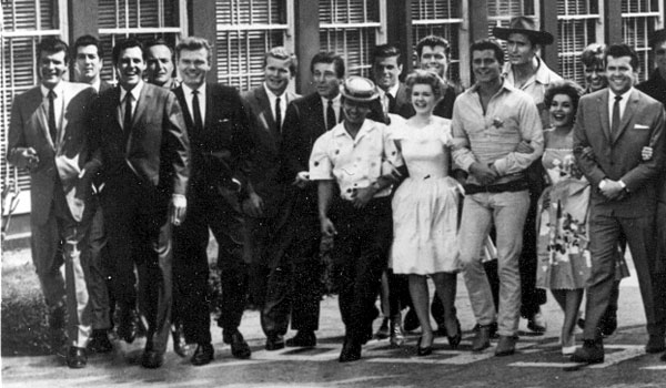 (L-R) Roger Moore, Ray Danton (?), Lee Patterson, unknown, Donald May, Gary Vinson, Effrem Zimbalist Jr., Poncie Ponce, Robert Logan, Connie Stevens, Sammy Jackson, Peter Brown, Clint Walker, Margarita Sierra, Will Hutchins, unknown.