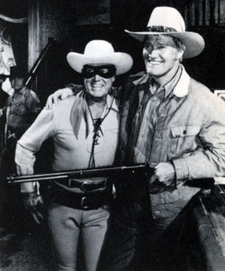 "n the set of ""When the West Was Fun: A Western Reunion"" ('79) with The Lone Ranger (Clayton Moore) and The Rifleman (Chuck Connors). George Montgomery can be glimpsed in the back."
