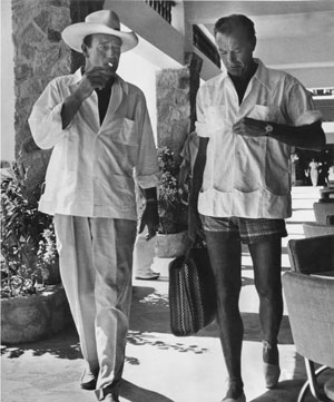 John Wayne and Gary Cooper dressed for a relaxing day at the beach.