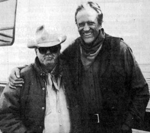 "Costumer Luster Bayless poses with James Arness on the set of ""Gunsmoke: To the Last Man"" in 1992."