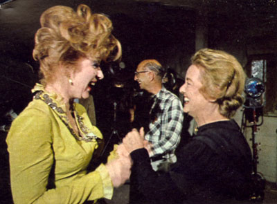 "Amanda Blake as Miss Kitty and ""Gunsmoke"" guest star Bette Davis share a laugh after a tough scene filming ""The Jailer"" episode in 1966."