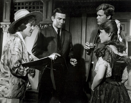 "Director Ida Lupino has a script conference with ""The Virginian"" James Drury, Doug McClure and guest star Alice Rawlings on the set of the ""Dead Eye Dick"" episode in 1966."