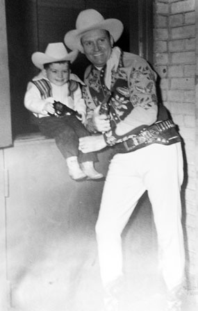 Gene Autry with a very young fan.