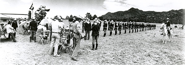 "Making TV's ""How the West Was Won"" in Canon City, CO. Top photo shows 60 Cavalry Troopers awaiting the arrival of Zeb Macahan (James Arness) and Chief Santangkai (Ricardo Montalban). Bottom photo depicts troopers maneuvering for attack during the Indian war."